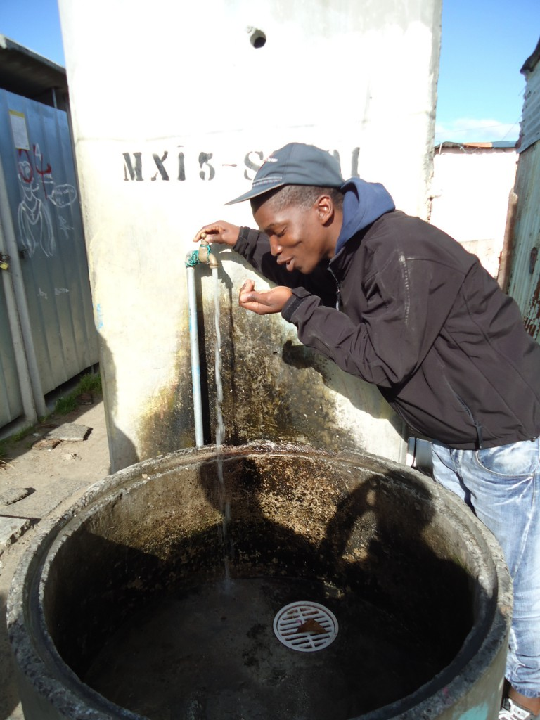 communal-water-tap-in-Khayelitsha-1-768x1024